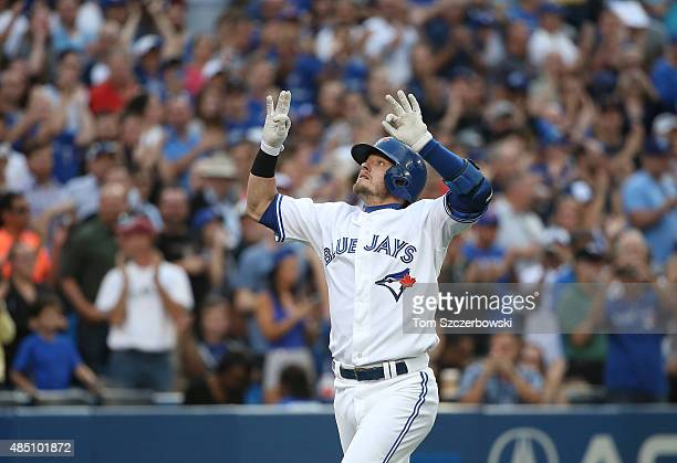 Josh Donaldson of the Toronto Blue Jays celebrates after hitting a two-run home run in the first inning during MLB game action against the Minnesota...