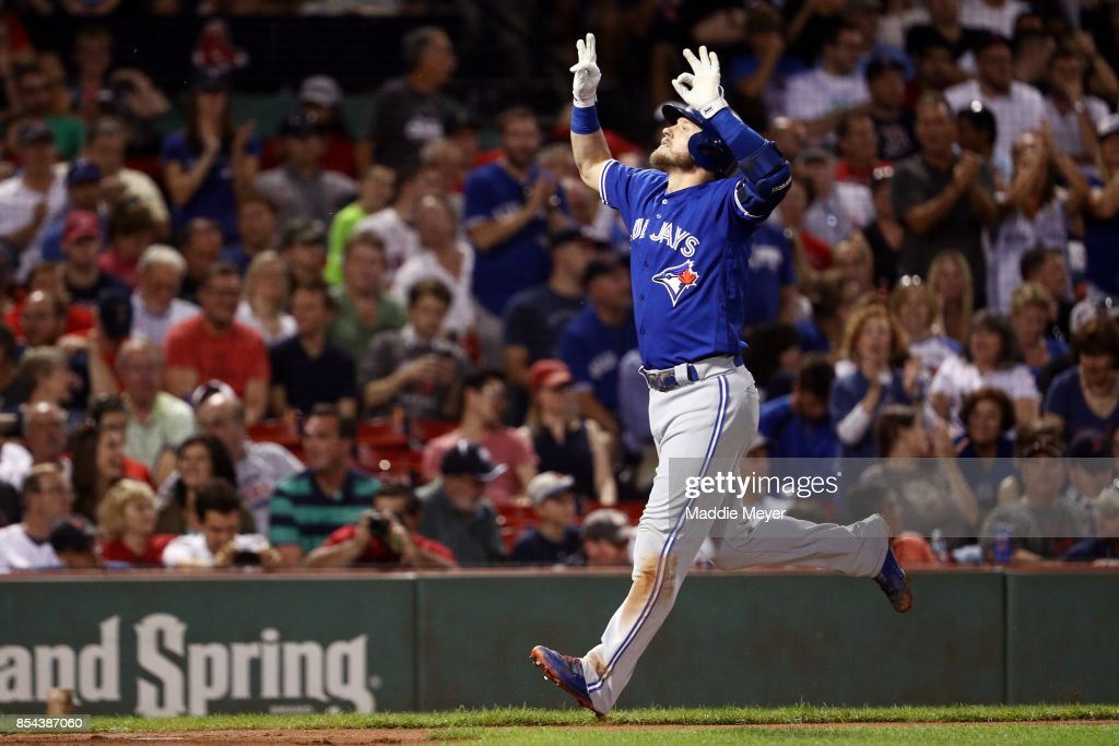 Josh Donaldson #20 of the Toronto Blue Jays celebrates after hitting a home run against the Boston Red Sox during the third inning at Fenway Park on September 26, 2017 in Boston, Massachusetts.