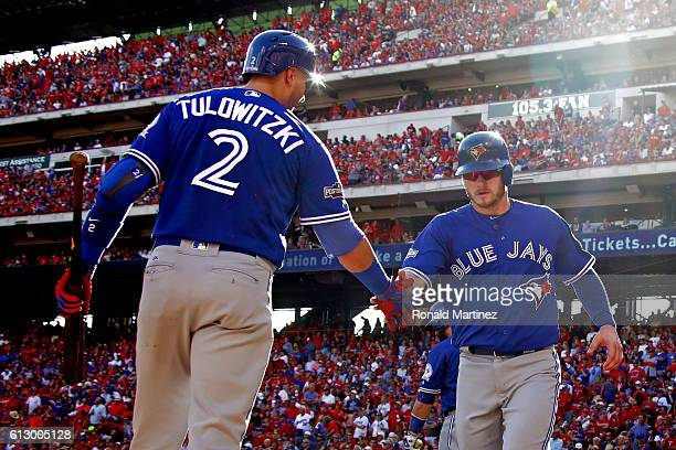 Josh Donaldson of the Toronto Blue Jays celebrates after scoring a run in the third inning against the Texas Rangers in game one of the American...