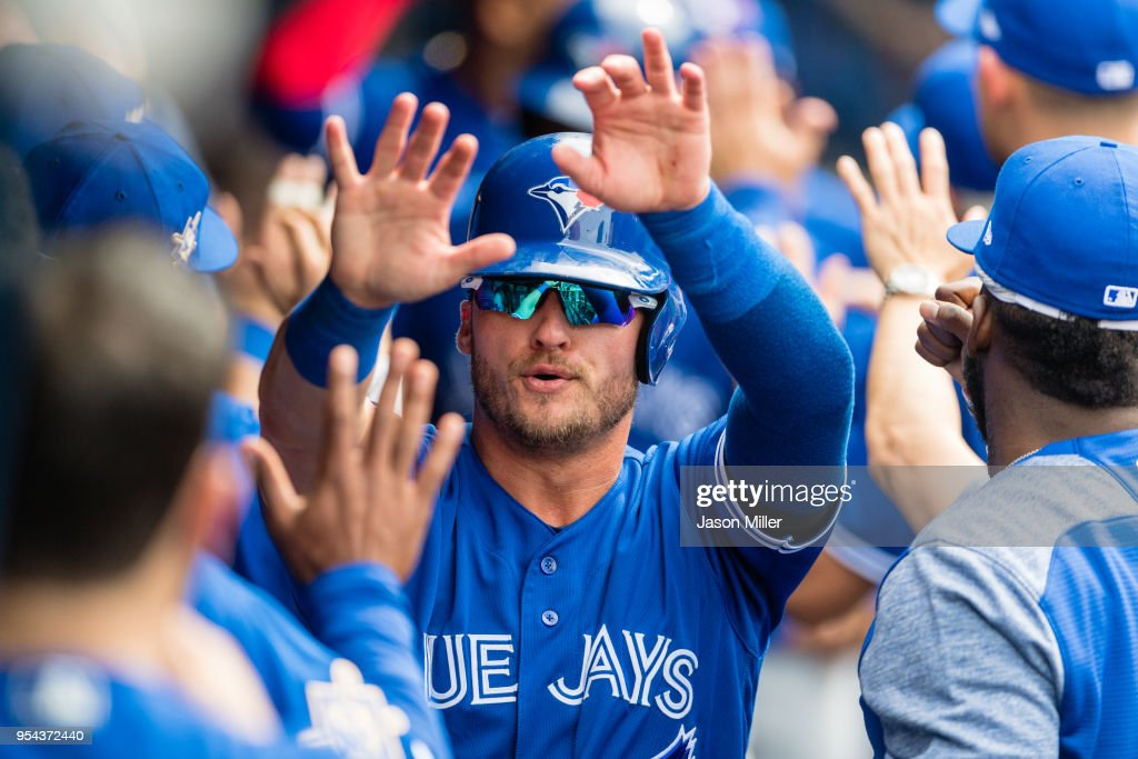 Josh Donaldson #20 of the Toronto Blue Jays celebrates after scoring off a single by Yangervis Solarte #26 during the fourth inning against the Cleveland Indians at Progressive Field on May 3, 2018 in Cleveland, Ohio. All players are wearing #42 in honor of Jackie Robinson Day in this makeup game from April 15.