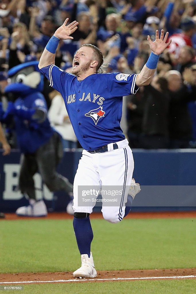 Josh Donaldson #20 of the Toronto Blue Jays celebrates defeating the Baltimore Orioles 5-2 to win the American League Wild Card game at Rogers Centre on October 4, 2016 in Toronto, Canada.