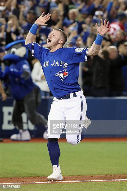 Josh Donaldson of the Toronto Blue Jays celebrates defeating the Baltimore Orioles 52 to win the American League Wild Card game at Rogers Centre on...
