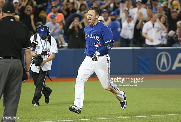 Josh Donaldson of the Toronto Blue Jays celebrates his gamewinning home run in the tenth inning during MLB game action against the Atlanta Braves on...
