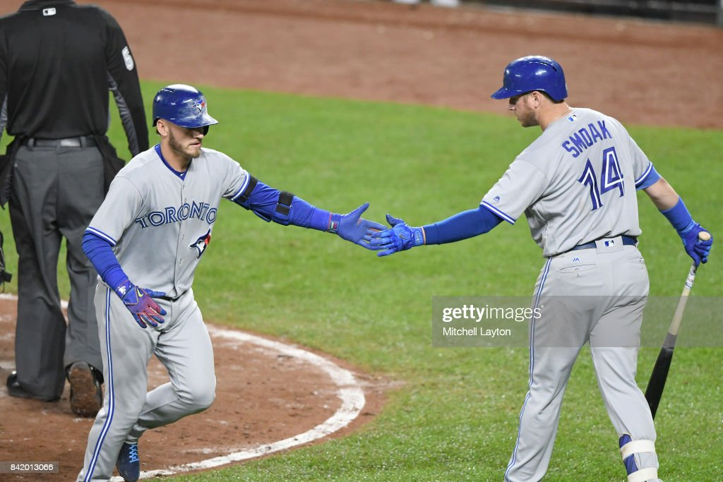 Josh Donaldson #20 of the Toronto Blue Jays celebrates hitting a three run home in the seventh inning with Justin Smoak #14 of the during a baseball game against the Baltimore Orioles at Oriole Park at Camden Yards on September 2, 2017 in Baltimore, Maryland.