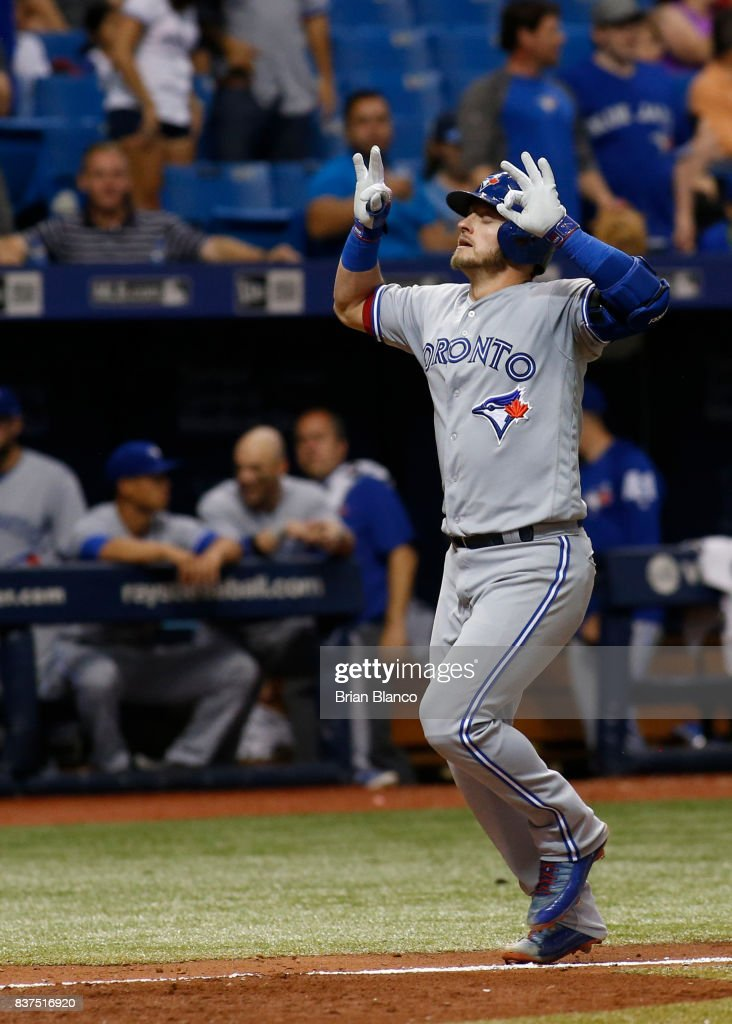 Josh Donaldson #20 of the Toronto Blue Jays celebrates near home plate after hitting a home run off of pitcher Tommy Hunter of the Tampa Bay Rays during the eighth inning of a game on August 22, 2017 at Tropicana Field in St. Petersburg, Florida.
