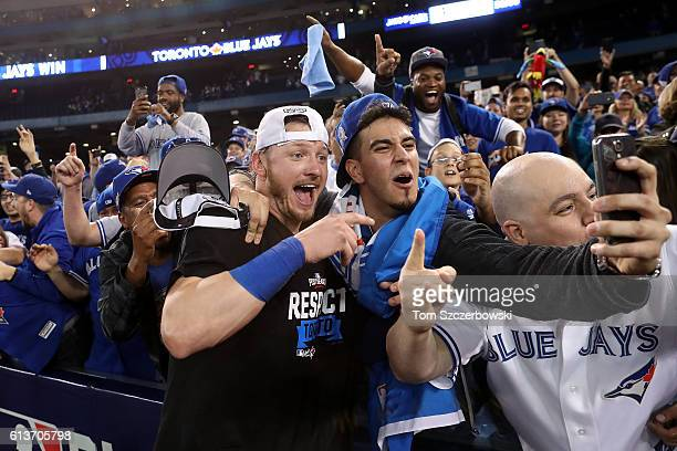 Josh Donaldson of the Toronto Blue Jays celebrates with fans after the Toronto Blue Jays defeated the Texas Rangers 7-6 for game three of the...