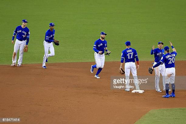 Josh Donaldson of the Toronto Blue Jays celebrates with his teammates after defeating the Cleveland Indians with a score of 5 to 1 in game four of...