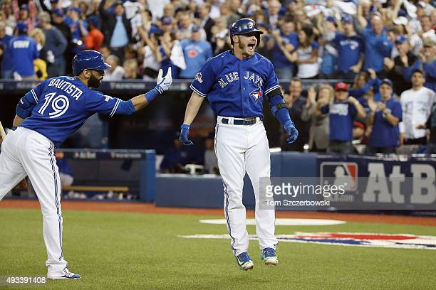 Josh Donaldson of the Toronto Blue Jays celebrates with Jose Bautista of the Toronto Blue Jays after hitting a tworun home run in the third inning...