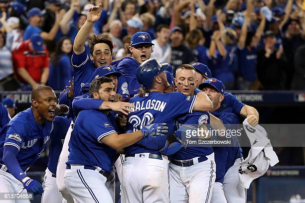 Josh Donaldson of the Toronto Blue Jays celebrates with teammates after the Toronto Blue Jays defeated the Texas Rangers 76 in ten innings during...