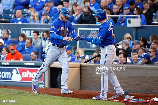 Josh Donaldson of the Toronto Blue Jays celebrates with Troy Tulowitzki of the Toronto Blue Jays after scoring a run in the sixth inning against the...