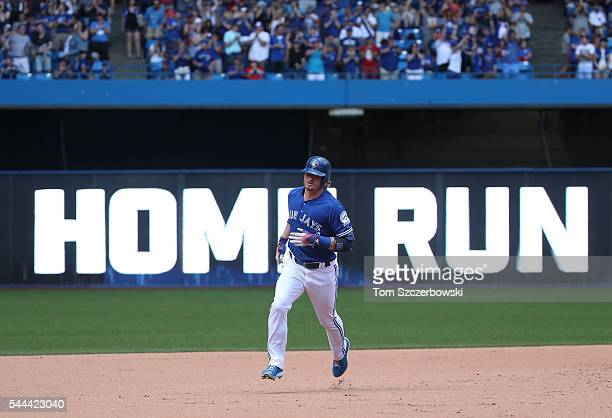Josh Donaldson of the Toronto Blue Jays circles the bases after hitting a solo home run in the seventh inning during MLB game action against the...