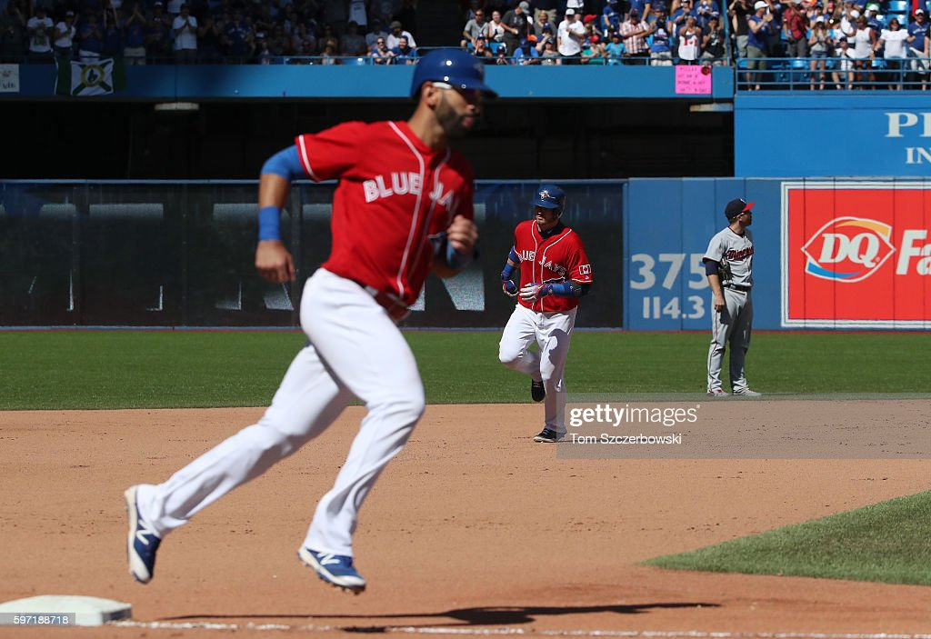 Josh Donaldson #20 of the Toronto Blue Jays circles the bases behind Jose Bautista #19 after hitting his second home run of the game in the seventh inning during MLB game action against the Minnesota Twins on August 28, 2016 at Rogers Centre in Toronto, Ontario, Canada.