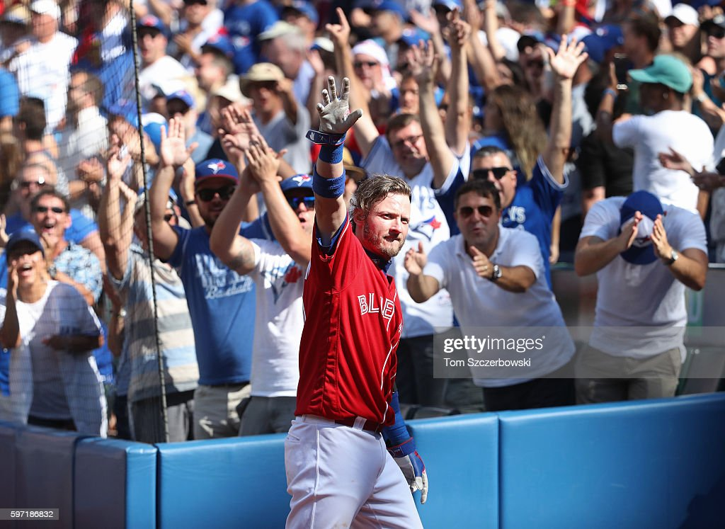 Josh Donaldson #20 of the Toronto Blue Jays comes out of the dugout for a curtain call after hitting his home run of the game in the eighth inning during MLB game action against the Minnesota Twins on August 28, 2016 at Rogers Centre in Toronto, Ontario, Canada.