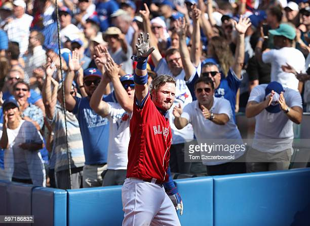 Josh Donaldson of the Toronto Blue Jays comes out of the dugout for a curtain call after hitting his home run of the game in the eighth inning during...