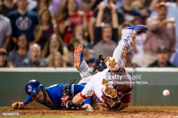 Josh Donaldson of the Toronto Blue Jays evades the tag of Christian Vazquez of the Boston Red Sox as he scores during the third inning of a game on...
