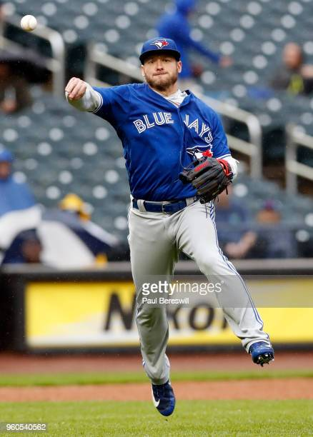 Josh Donaldson of the Toronto Blue Jays fields a ground ball and throws to first base in an interleague MLB baseball game against the New York Mets...