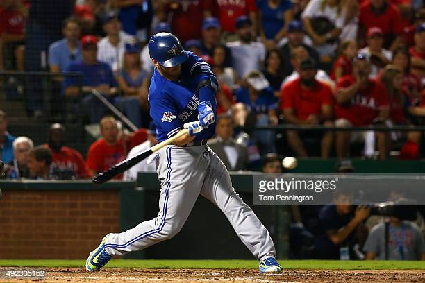Josh Donaldson of the Toronto Blue Jays hits a double to deep right center in the fourth inning against Martin Perez of the Texas Rangers during game...