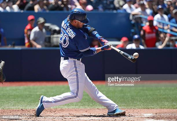 Josh Donaldson of the Toronto Blue Jays hits a grand slam home run in the third inning during MLB game action against the Philadelphia Phillies on...