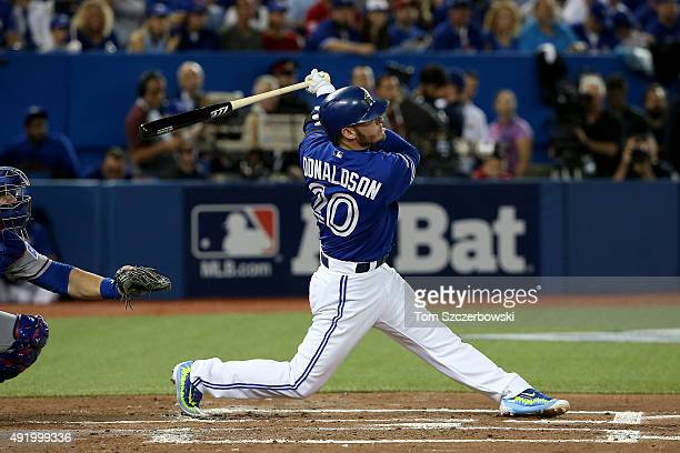 Josh Donaldson of the Toronto Blue Jays hits a solo home run in the first inning against the Texas Rangers during game two of the American League...