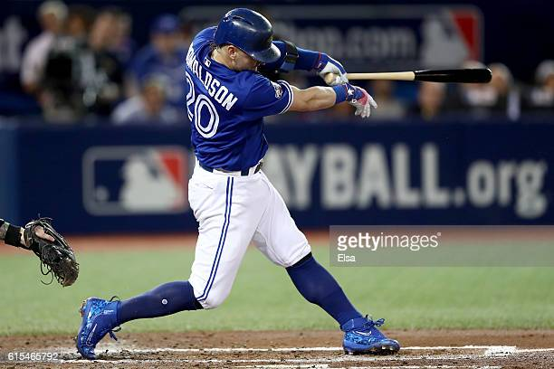 Josh Donaldson of the Toronto Blue Jays hits a solo home run in the third inning against Corey Kluber of the Cleveland Indians during game four of...