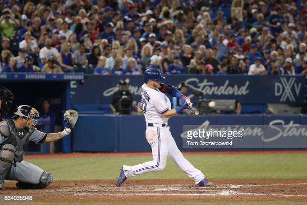 Josh Donaldson of the Toronto Blue Jays hits a solo home run in the fifth inning during MLB game action against the Tampa Bay Rays at Rogers Centre...