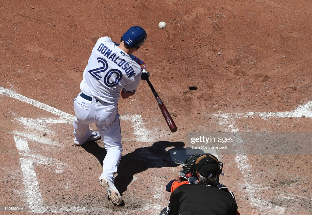 Josh Donaldson #20 of the Toronto Blue Jays hits a three-run home run in the fifth inning during MLB game action against the Houston Astros at Rogers Centre on July 8, 2017 in Toronto, Canada.