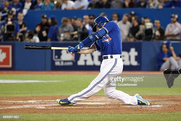 Josh Donaldson of the Toronto Blue Jays hits a tworun home run in the third inning against the Kansas City Royals during game three of the American...