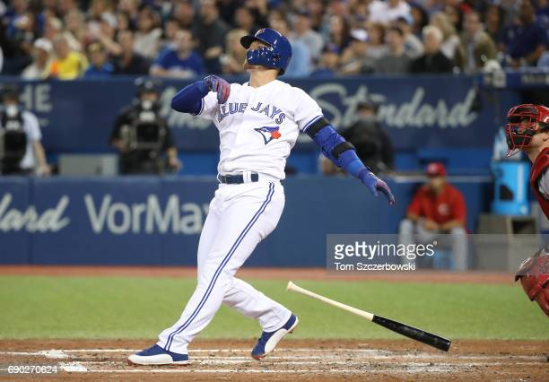 Josh Donaldson of the Toronto Blue Jays hits a tworun home run in the fourth inning during MLB game action against the Cincinnati Reds at Rogers...