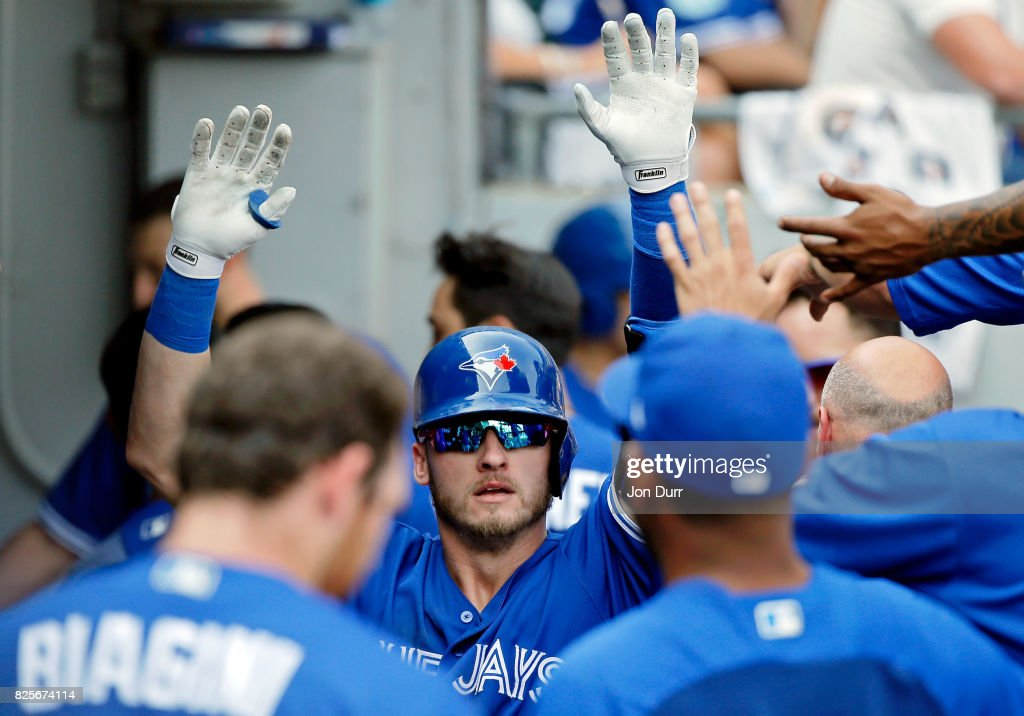Josh Donaldson #20 of the Toronto Blue Jays is congratulated in the dugout after hitting a home run against the Chicago White Sox during the ninth inning at Guaranteed Rate Field on August 2, 2017 in Chicago, Illinois. The Toronto Blue Jays won 5-1.
