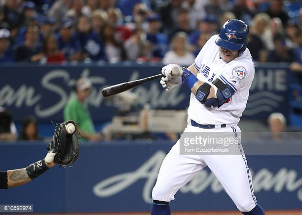 Josh Donaldson of the Toronto Blue Jays is hit by pitch in the first inning during MLB game action against the New York Yankees on September 26 2016...