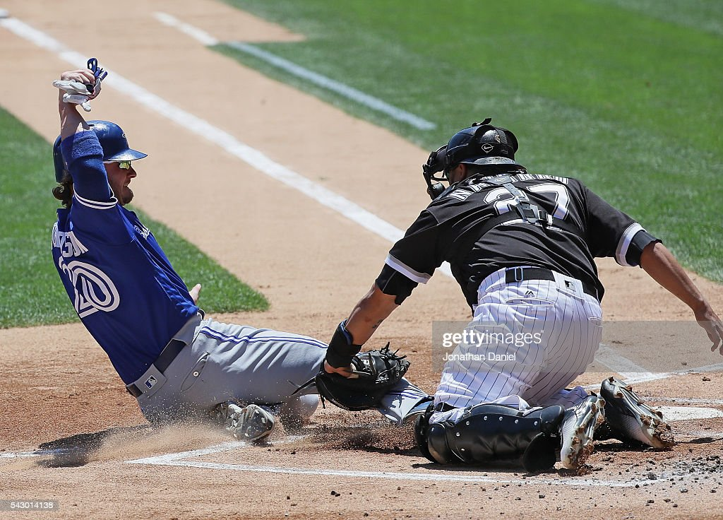 Josh Donaldson #20 of the Toronto Blue Jays is tagged out at the plate by Dioner Navarro #27 of the Chicago White Sox in the 1st inning at U.S. Cellular Field on June 25, 2016 in Chicago, Illinois.