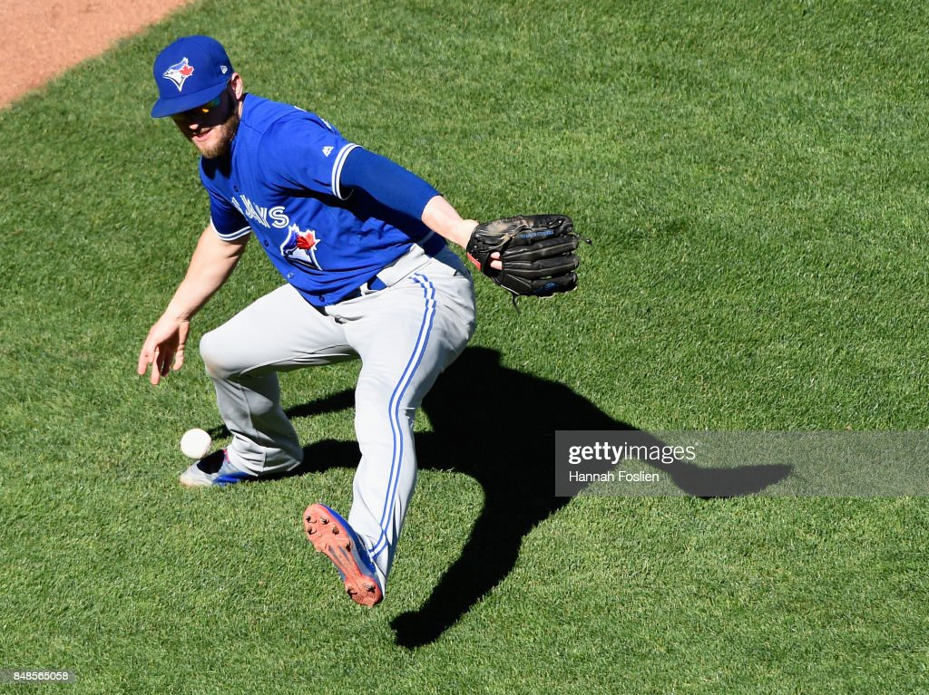 Josh Donaldson #20 of the Toronto Blue Jays is unable to field a bunt single by Brian Dozier #2 of the Minnesota Twins during the fifth inning of the game on September 17, 2017 at Target Field in Minneapolis, Minnesota. The Twins defeated the Blue Jays 13-7.