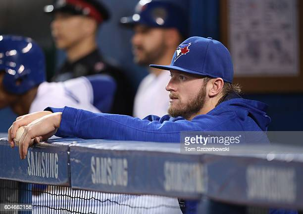 Josh Donaldson of the Toronto Blue Jays looks on from the top step of the dugout as he sits out his second straight game during MLB game action...