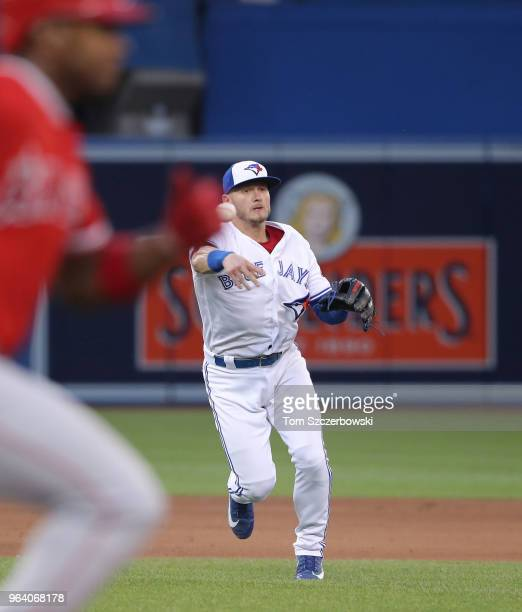 Josh Donaldson of the Toronto Blue Jays makes the play and throws out Justin Upton of the Los Angeles Angels of Anaheim in the fifth inning during...