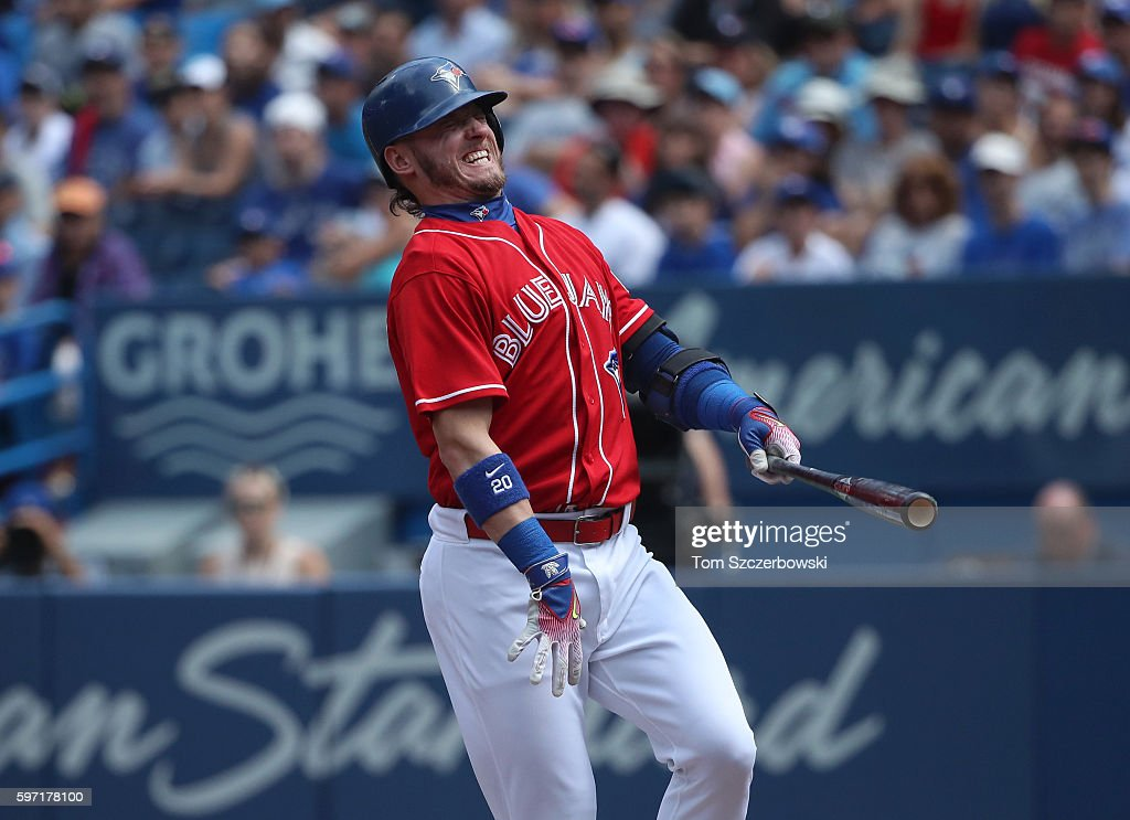 Josh Donaldson #20 of the Toronto Blue Jays reacts after fouling a ball off his leg in the first inning during MLB game action against the Minnesota Twins on August 28, 2016 at Rogers Centre in Toronto, Ontario, Canada.