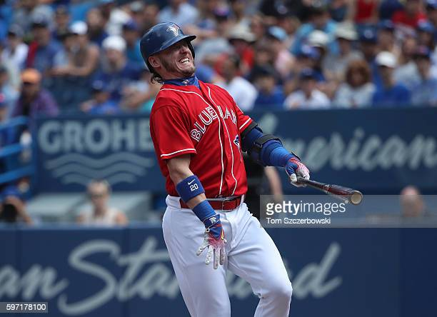 Josh Donaldson of the Toronto Blue Jays reacts after fouling a ball off his leg in the first inning during MLB game action against the Minnesota...