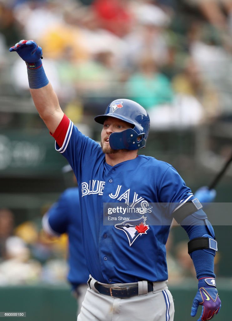 Josh Donaldson #20 of the Toronto Blue Jays reacts after he hit a two-run home run in the tenth inning against the Oakland Athletics at Oakland Alameda Coliseum on June 7, 2017 in Oakland, California.