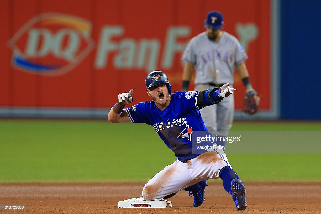 Josh Donaldson #20 of the Toronto Blue Jays reacts after hitting a double in the tenth inning against the Texas Rangers during game three of the American League Division Series at Rogers Centre on October 9, 2016 in Toronto, Canada.