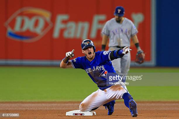 Josh Donaldson of the Toronto Blue Jays reacts after hitting a double in the tenth inning against the Texas Rangers during game three of the American...