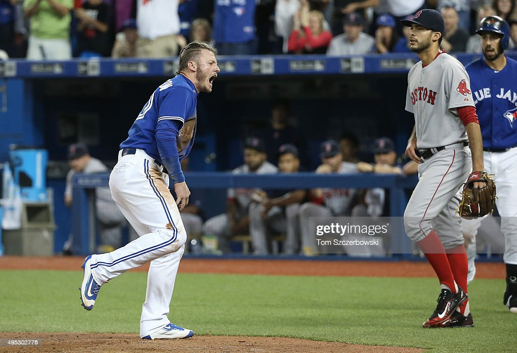 Josh Donaldson #20 of the Toronto Blue Jays reacts after scoring a run in the eighth inning during MLB game action as Noe Ramirez #66 of the Boston Red Sox looks on on September 19, 2015 at Rogers Centre in Toronto, Ontario, Canada.