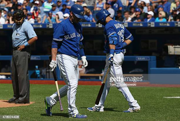Josh Donaldson of the Toronto Blue Jays reacts after striking out as Jose Bautista heads to the plate in the eighth inning during MLB game action...