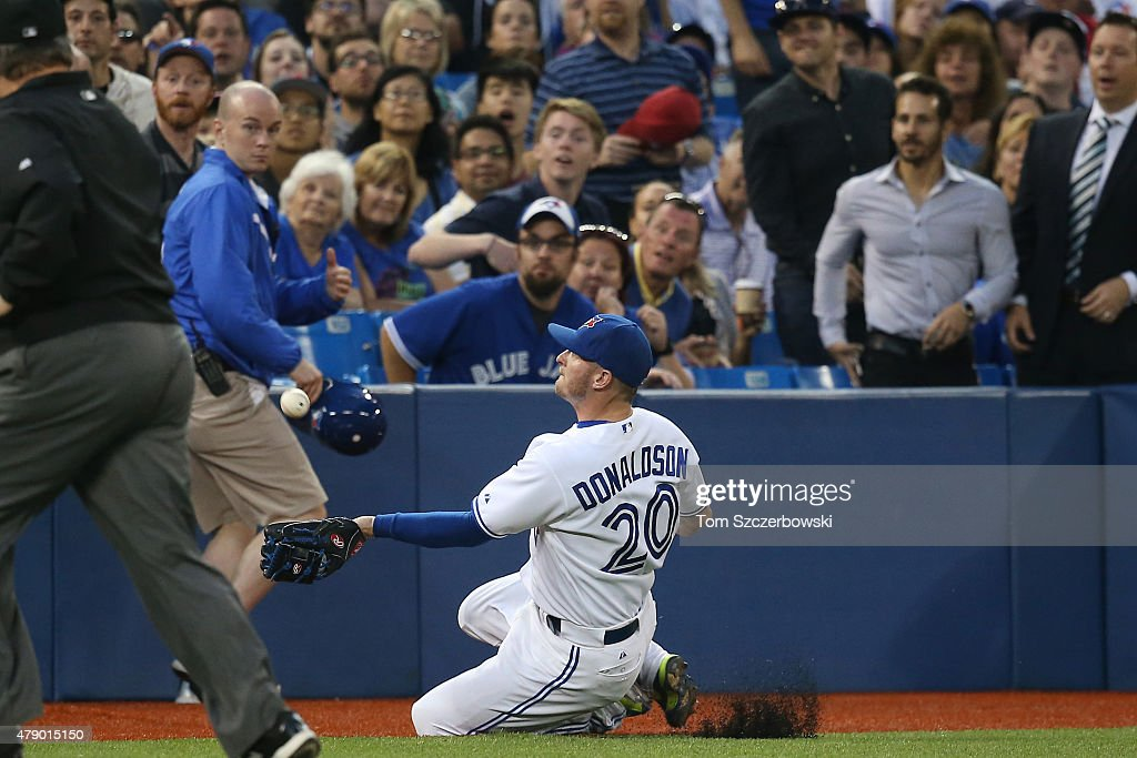Josh Donaldson #20 of the Toronto Blue Jays runs makes a sliding catch on a foul pop up in the seventh inning during MLB game action against the Boston Red Sox on June 29, 2015 at Rogers Centre in Toronto, Ontario, Canada.