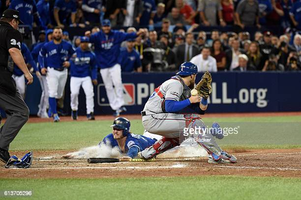 Josh Donaldson of the Toronto Blue Jays slides home to score the winning run in the bottom of the 10th inning of Game 3 of the ALDS to defeat the...