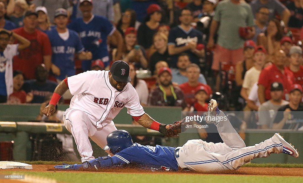 Josh Donaldson #20 of the Toronto Blue Jays slides in to third as Pablo Sandoval #48 of the Boston Red Sox prepares to hit the tag in the tenth inning at Fenway Park on September 8, 2015 in Boston, Massachusetts.