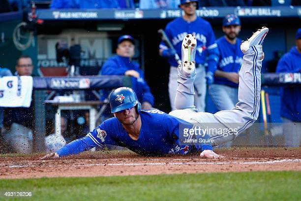 Josh Donaldson of the Toronto Blue Jays slides safely into home to score a run in the sixth inning against the Kansas City Royals in game two of the...