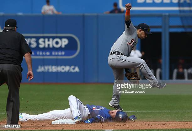 Josh Donaldson of the Toronto Blue Jays slides safely into second base as he advances on a fiederâs choice after hitting an RBI single in the sixth...