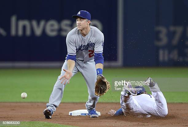 Josh Donaldson of the Toronto Blue Jays slides safely into second base as he steals the base in the first inning during MLB game action as Chase...
