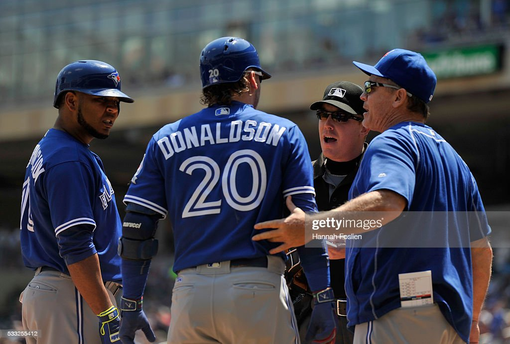 Josh Donaldson #20 of the Toronto Blue Jays speaks with home plate umpire Toby Basner #99 after being tossed as teammate Edwin Encarnacion #10 and manager John Gibbons #5 look on during the first inning of the game against the Minnesota Twins on May 21, 2016 at Target Field in Minneapolis, Minnesota.