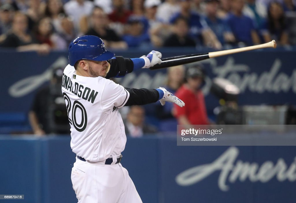 Josh Donaldson #20 of the Toronto Blue Jays swings and loses his bat in the fifth inning during MLB game action against the Cincinnati Reds at Rogers Centre on May 29, 2017 in Toronto, Canada.