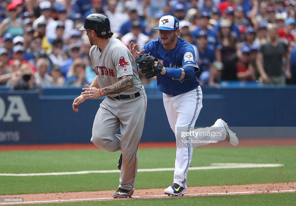 Josh Donaldson #20 of the Toronto Blue Jays tags out Blake Swihart #23 of the Boston Red Sox in a run-down in the seventh inning during MLB game action on May 29, 2016 at Rogers Centre in Toronto, Ontario, Canada.